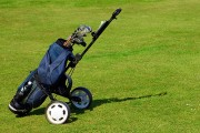 a golf bag on a green fairway