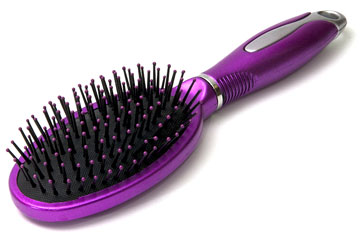 a purple hairbrush