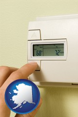 alaska map icon and a heating system thermostat