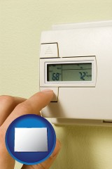 colorado map icon and a heating system thermostat