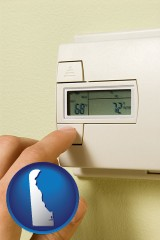 delaware map icon and a heating system thermostat