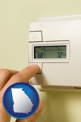 georgia map icon and a heating system thermostat