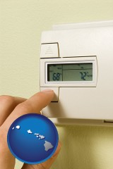 hawaii map icon and a heating system thermostat