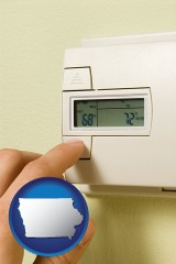iowa map icon and a heating system thermostat