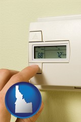 idaho map icon and a heating system thermostat