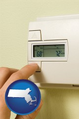massachusetts map icon and a heating system thermostat