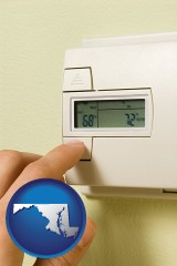 maryland map icon and a heating system thermostat