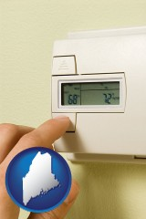 maine map icon and a heating system thermostat