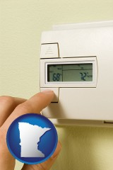 minnesota map icon and a heating system thermostat