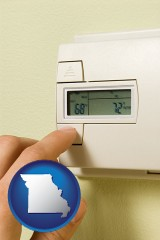 missouri map icon and a heating system thermostat