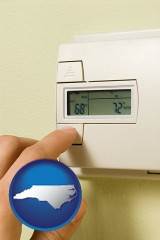 north-carolina map icon and a heating system thermostat