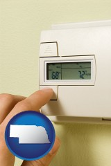 nebraska map icon and a heating system thermostat