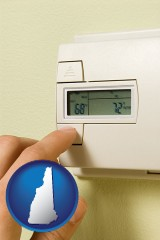 new-hampshire map icon and a heating system thermostat