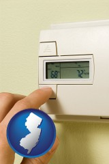 new-jersey map icon and a heating system thermostat