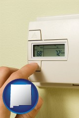 new-mexico map icon and a heating system thermostat