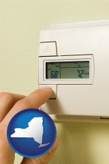 new-york map icon and a heating system thermostat