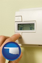 oklahoma map icon and a heating system thermostat