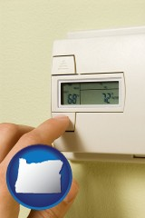 oregon map icon and a heating system thermostat
