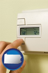 pennsylvania map icon and a heating system thermostat