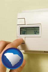 south-carolina map icon and a heating system thermostat