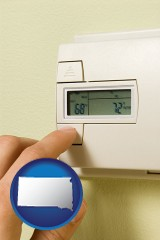 south-dakota map icon and a heating system thermostat