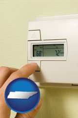 tennessee map icon and a heating system thermostat