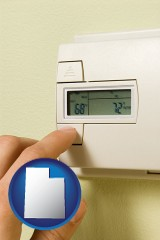 utah map icon and a heating system thermostat