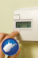 west-virginia map icon and a heating system thermostat