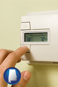 a heating system thermostat - with Alabama icon