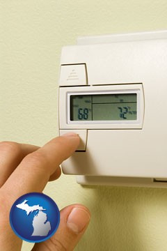 a heating system thermostat - with Michigan icon