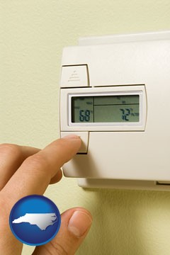 a heating system thermostat - with North Carolina icon