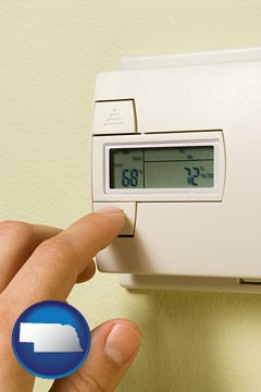 a heating system thermostat - with Nebraska icon