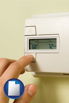 a heating system thermostat - with Utah icon