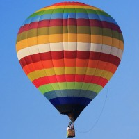 a hot air balloon against a blue sky background