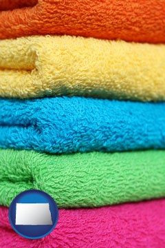 colorful bath towels - with North Dakota icon