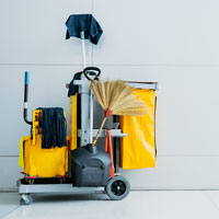 a janitorial cart and cleaning products