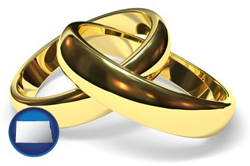 wedding rings - with North Dakota icon
