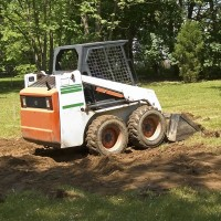 landscaping equipment (a skid-steer loader)
