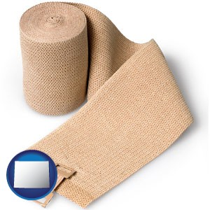 a medical bandage - with Wyoming icon