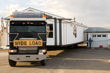 a wide-load mobile home transporter