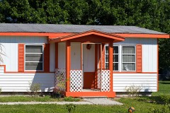 a mobile home with orange trim