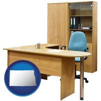 north-dakota map icon and office furniture (a desk, chair, bookcase, and cabinet)