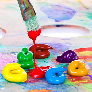colorful oil paints and paintbrush