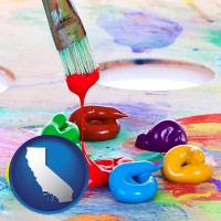 california colorful oil paints and paintbrush