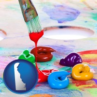 delaware colorful oil paints and paintbrush