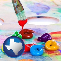 texas colorful oil paints and paintbrush