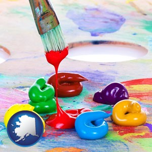 colorful oil paints and paintbrush - with Alaska icon