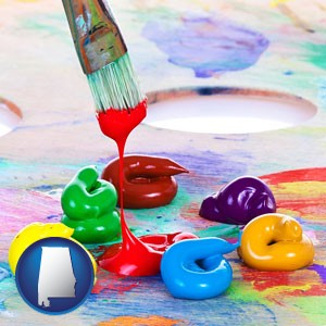 colorful oil paints and paintbrush - with Alabama icon