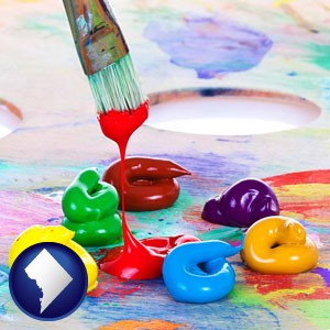colorful oil paints and paintbrush - with Washington, DC icon