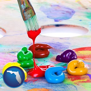 colorful oil paints and paintbrush - with Florida icon